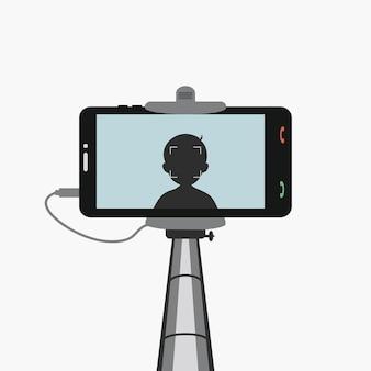 모노포드 셀카 스마트폰 화면에 남자의 실루엣이 있는 스마트폰은 자신을 사진에 담습니다.