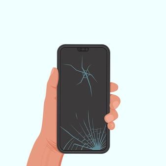 손에 금이 간 화면이있는 휴대 전화