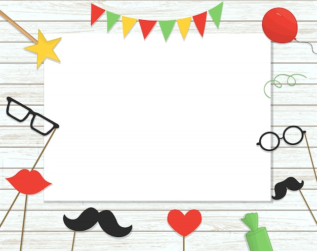 Photo booth props on stick, balloons, confetti, presents, candies on shabby wooden background with place for text