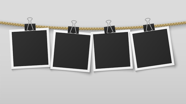 Photo frame hanging on rope. blank photo paper frames, retro picture exhibition with and clothespins.  image clean decoration vertical wall card album