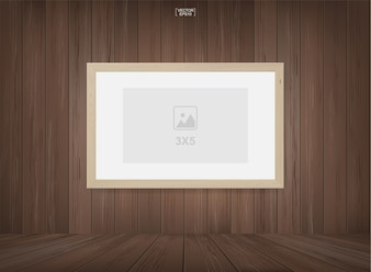 Photo frame in wooden room space background.
