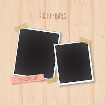 Photo frames on a wooden background