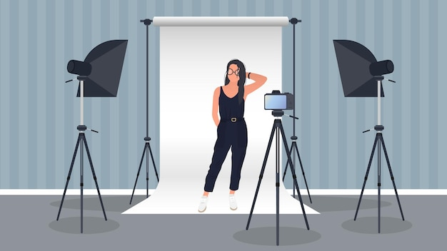 Photo studio. girl posing to the camera.
