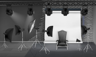 Photo studio interior with empty armchair, gray brick wall, white projector screen, spotlight