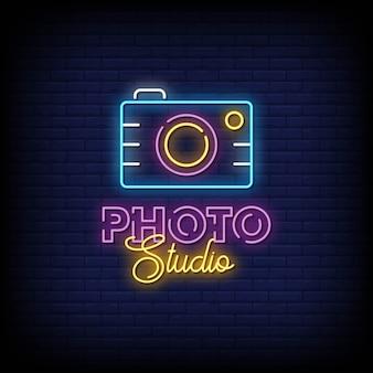 Photo studio neon signboard on brick wall
