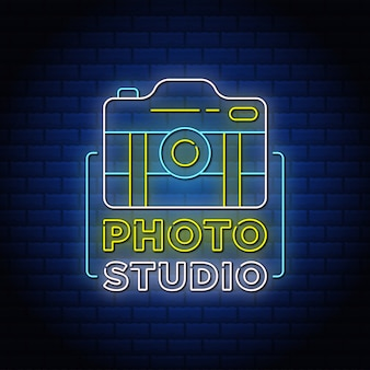 Photo studio neon signs style text with camera icon.