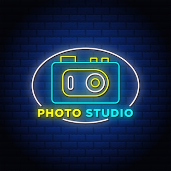 Photo studio neon style text signs with camera icon in blue background.