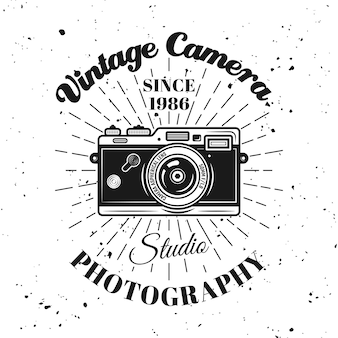 Photo studio vector emblem, label, badge or logo with camera and retro rays in monochrome style isolated on textured background