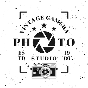 Photo studio vector typographical emblem, label, badge or logo in vintage monochrome style isolated on background with removable grunge texture