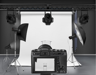 Photo studio with white roll-up screen, digital camera, spotlights and softboxes