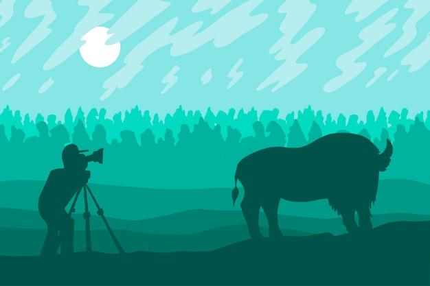 사진 작가는 산림 보호 구역에서 들소를 촬영합니다. 벡터