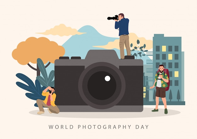 世界写真デーのお祝いのための大きなカメラを持つカメラマン