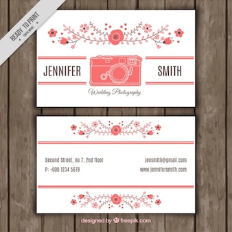 Photography business card with floral shapes