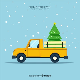 Pick up truck transporting christmas tree