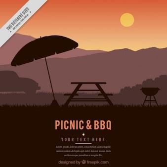 ピクニックやバーベキューの夕日の背景