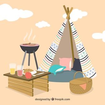 Picnic e barbecue con uno sfondo tepee