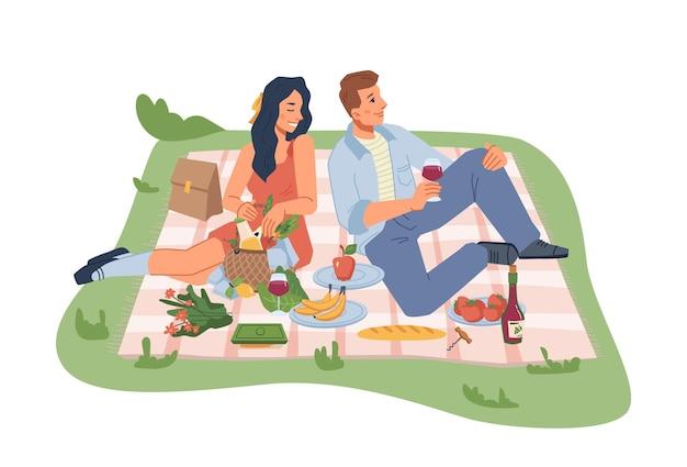 자연 남자와 여자는 와인 과일과 야채 평면 절연 담요에 앉아 피크닉