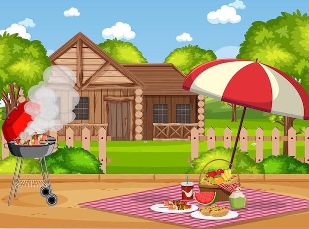 テーブルの上に食べ物と庭のバーベキューグリルでピクニックシーン