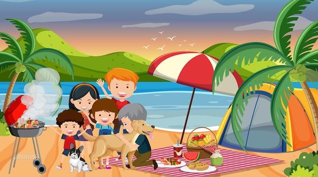 해변에서 행복한 가족과 함께 피크닉 장면