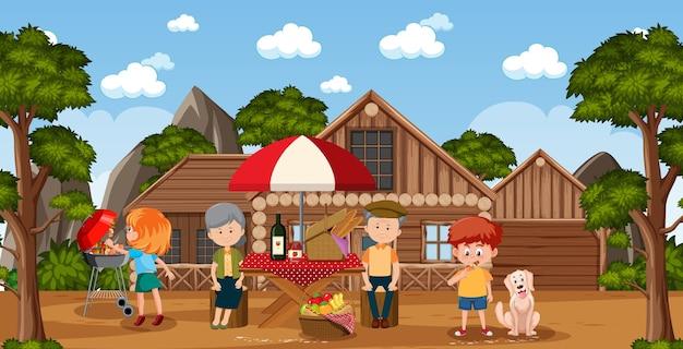 Picnic scene with happy family in the garden