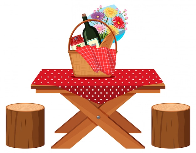 Picnic table with food basket and drink on it