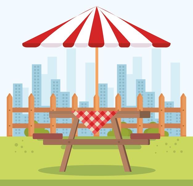 Picnic table with umbrella outdoor scene