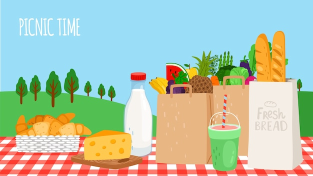 Picnic time. fresh food, vegetables and fruits, shake and bread on table.
