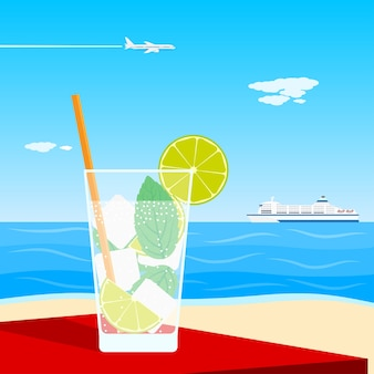 Picture of a cocktail standing on table in front of seaside