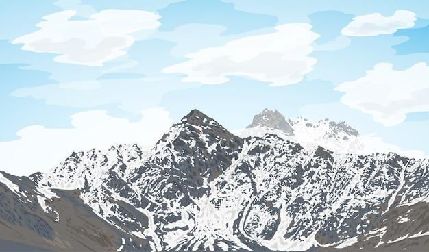 背景、旅行、観光、ハイキング、トレッキングのコンセプトに雲と雪に覆われた山脈の写真