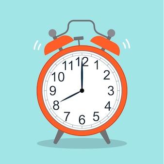赤い目覚まし時計の写真