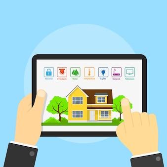 家とその画面、スマートホームのコンセプト、スタイルの図のアイコンとタブレットの画像