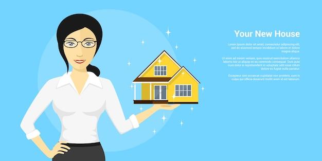 彼女の手のひら、家の広告、スタイルの図に新しい家を保持している若い女性の写真