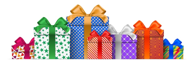 Pile of different height gift boxes, with colorful wrapping patterns, standing isolated on the white background.
