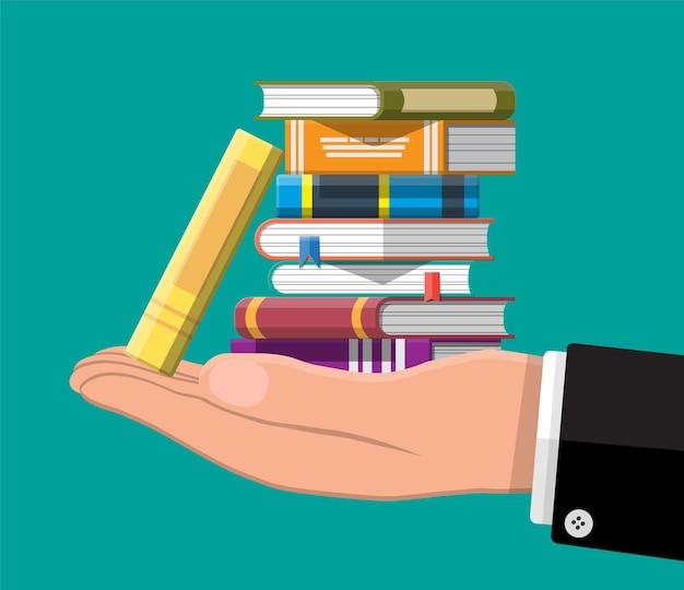 Куча книг в руке иллюстрации