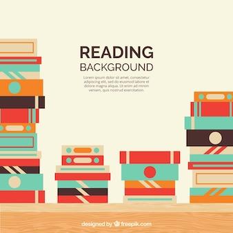 Pile di libri sfondo in design piatto