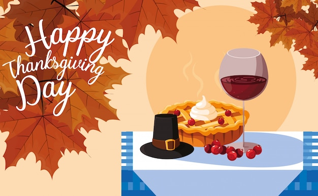 Pilgrim hat with pie and cup wine in table