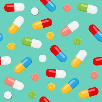Pills and medicines seamless pattern on blue background