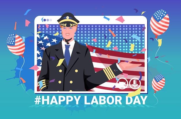アメリカの旗を保持している制服を着たパイロットの幸せな労働者の日のお祝い