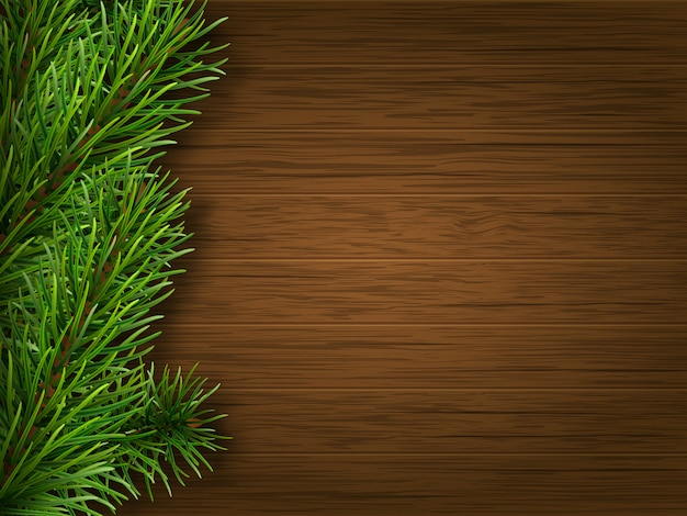 Pine branch on old brown wooden background