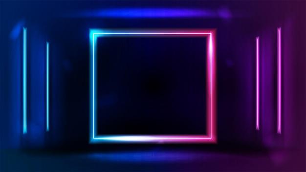 벽의 어두운 방에 선 네온 램프가 있는 분홍색 및 파란색 그라데이션 네온 빈 사각형 프레임