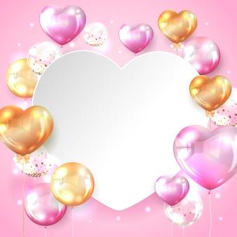 ハート形のコピースペースとピンクとゴールドの光沢のあるバルーン