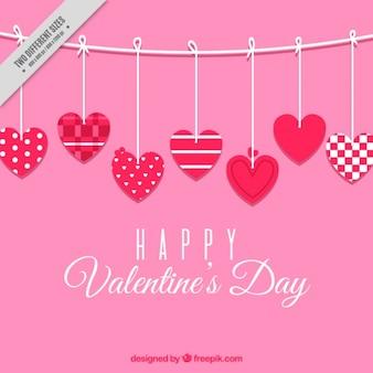 バレンタインデーのための異なるデザインとハートのピンクの背景