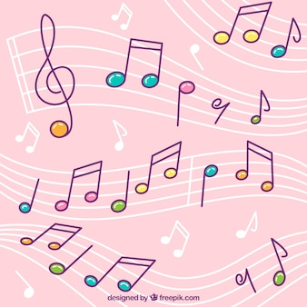 カラフルな音符と五芒星のピンクの背景