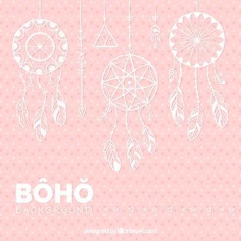 Pink background with flat dreamcatchers hanging