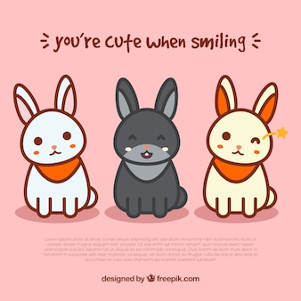 Pink background with three happy rabbits