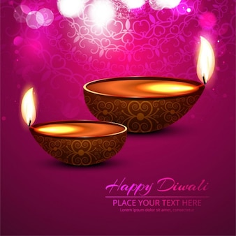Pink background with two candles to celebrate diwali