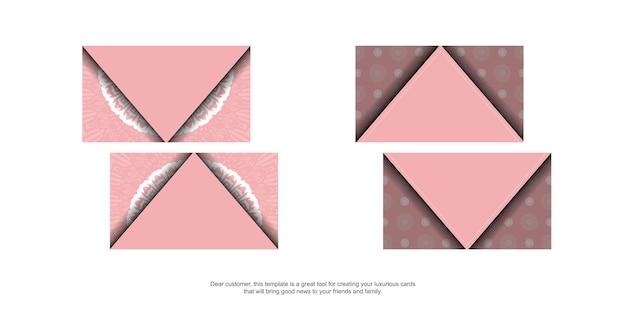 あなたのビジネスのための曼荼羅の白いパターンとピンクの名刺。