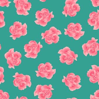 Розовый цветок гвоздики на зеленом фоне.