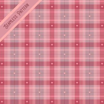 ピンクの市松模様とハートのシームレスなパターン