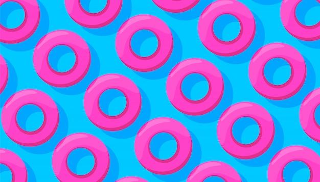 最小限のスタイルで青の背景に水泳パターンのピンクの円。夏のコンセプト